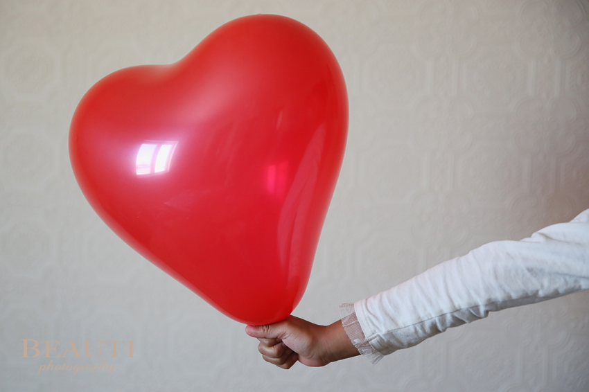 Valentine Day heart shaped balloon red and white photo