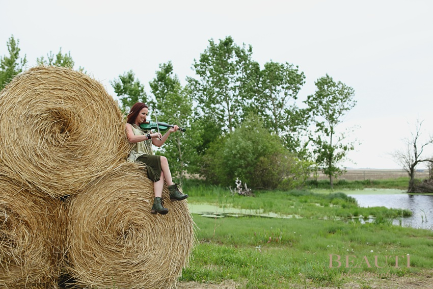 GCJ Stables Cowgirl Makeovers Arbonne makeup portrait shoot hay bales violin photo