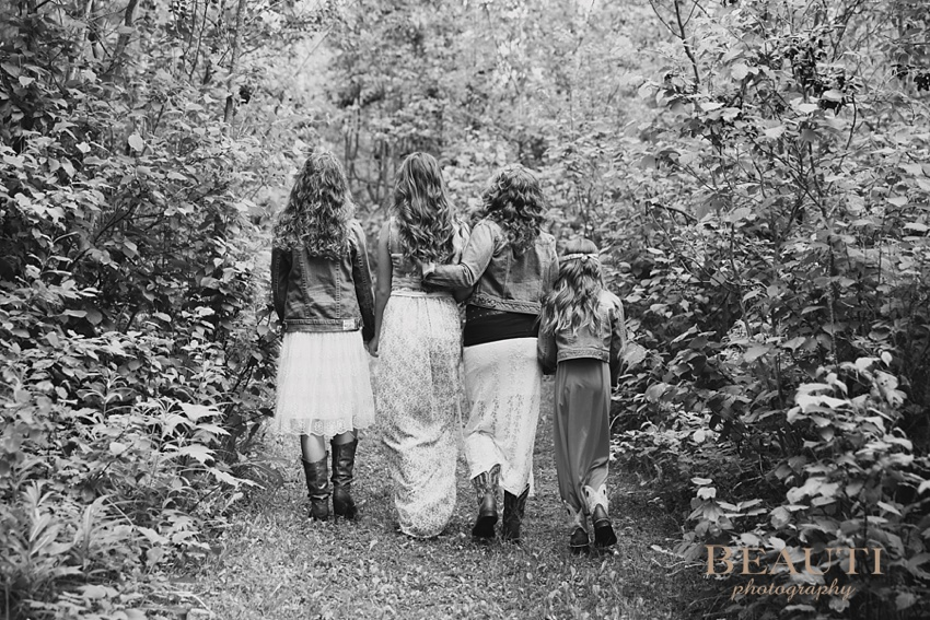 lifestyle portrait photography Beaumont Alberta travel portrait photographer mother and daughters walking photo