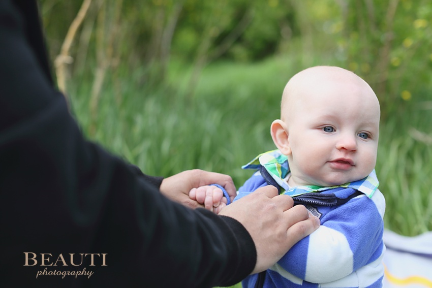 Tribune Saskatchewan family lifestyle portrait photographer outdoor lifestyle photography 6 month old baby boy holding daddy