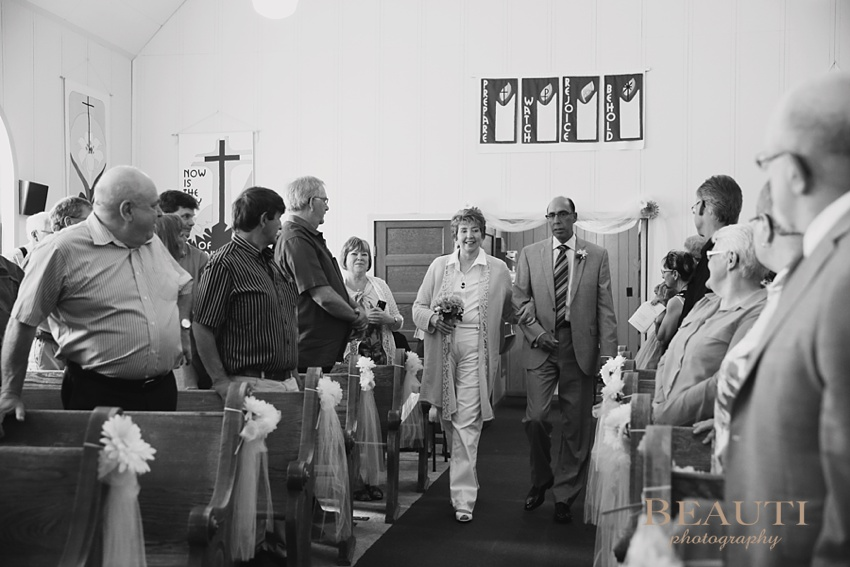 Saskatchewan wedding portrait photographer Bromhead church wedding ceremony At Last wedding photography wedding ceremony processional photo