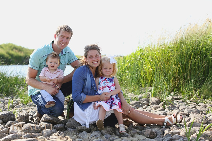 Tribune Saskatchewan family lifestyle outdoor photographer natural light photography prairie scenery adorable happy family well coordinated outfits sitting by river photo