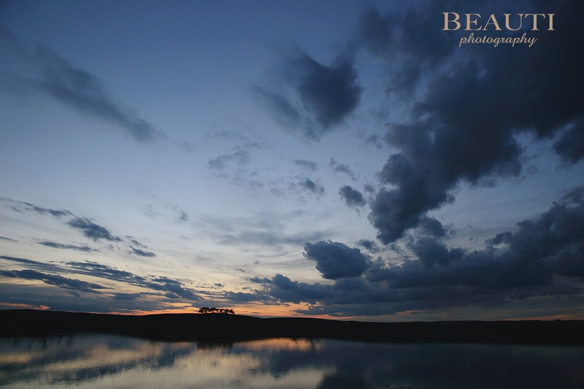 Tribune Saskatchewan lifestyle photographer outdoor prairie photography Land of Living Skies colourful prairie skies prairie lake beautiful sunset photo
