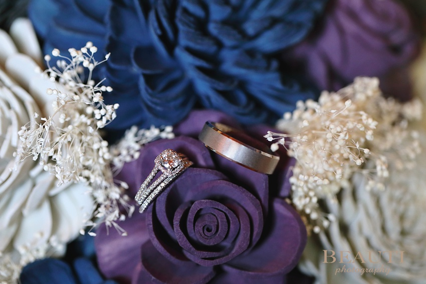 BEAUTI photography Saskatchewan wedding photographer Kenosee Lake wedding wooden wedding flowers bouquet happy couple in love wedding day Kenosee Moose Mountain Park Sola Flowers Canada wedding rings engagement ring shot wedding details photo