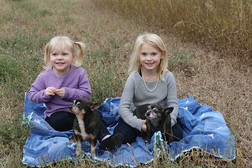 BEAUTI photography Tribune Saskatchewan family lifestyle photographer outdoor family portraits lifestyle photographer farm photography Oungre family farm outdoor sisters portrait pups photo