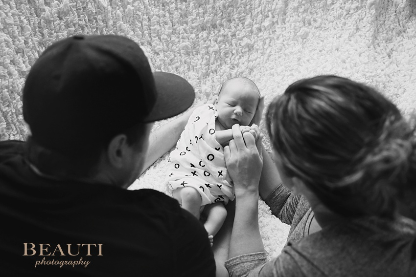 BEAUTI photography Tribune Saskatchewan portrait photographer Langley British Columbia newborn lifestyle photography sweet adorable baby boy our newest nephew precious newborn parents admiring newborn photo