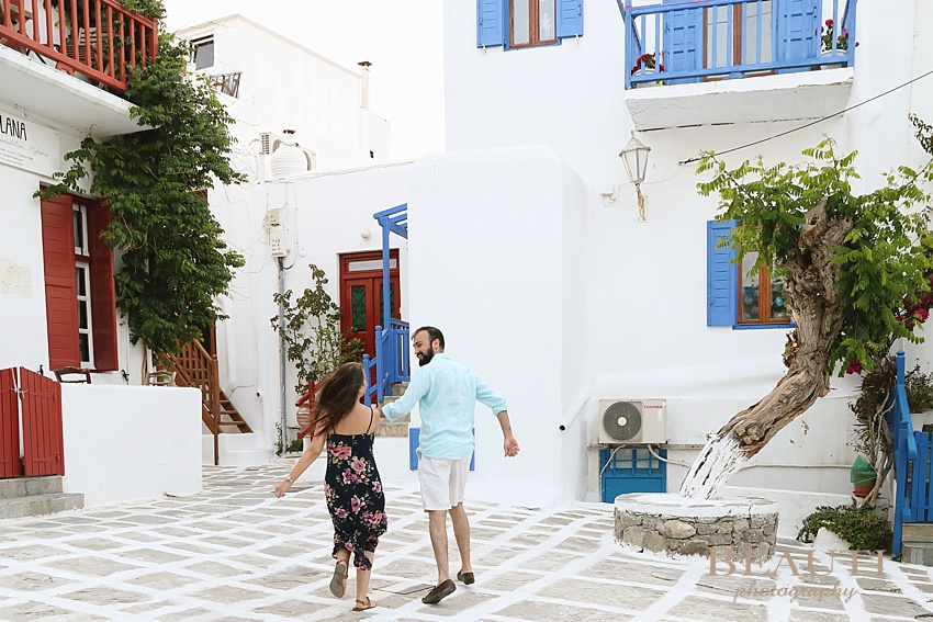 Mykonos Greece honeymoon destination photographer couple honeymooning sunset portraits streets of Mykonos lifestyle couple running Greece photo